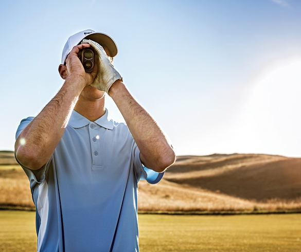 Man using a rangefinder on the golf course - 13203