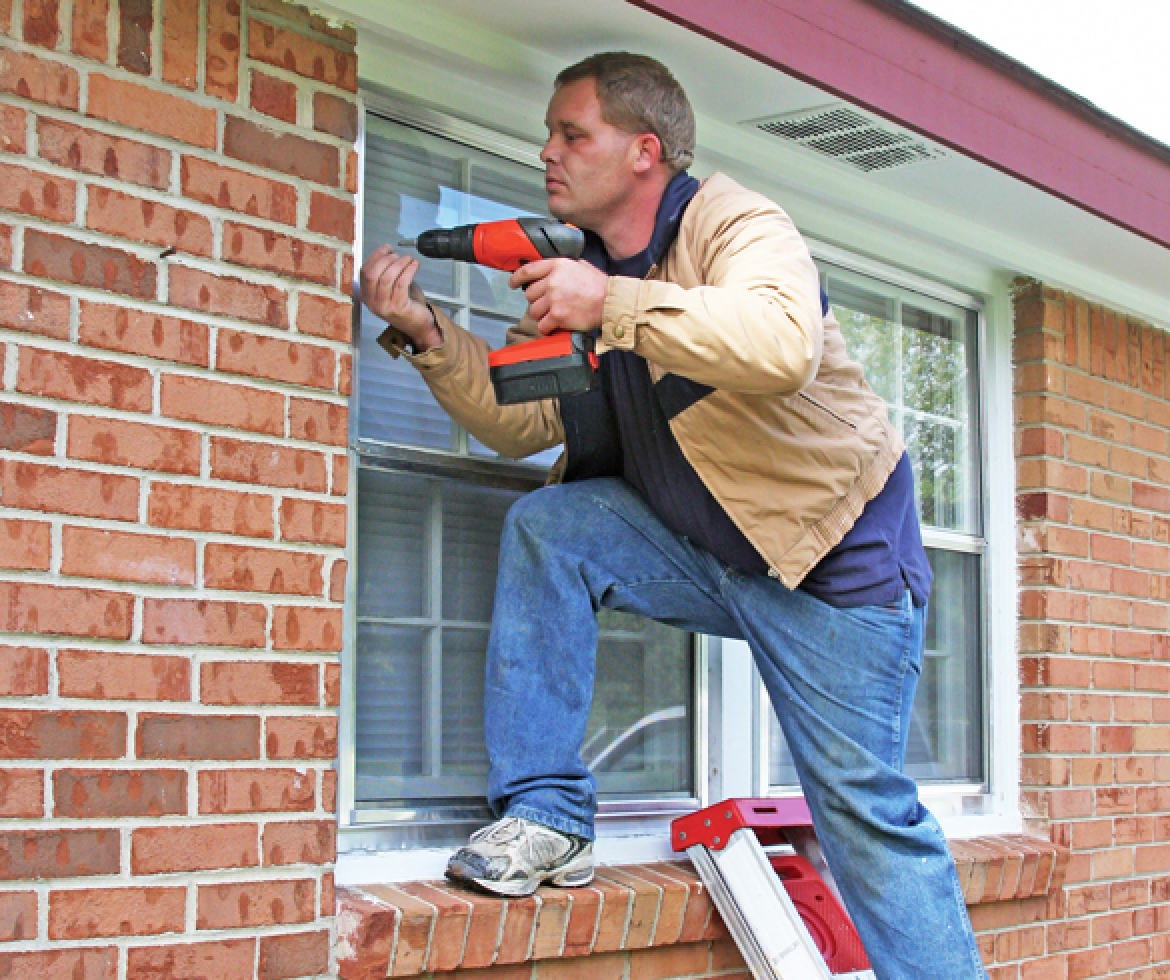 Man using screw gun to make house repairs. re?id=2815