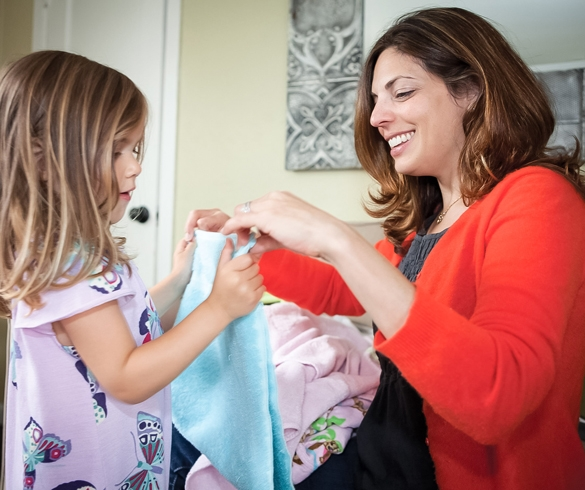 Mother and child folding laundry. re?id=3684 redirect from clean home for holidays  re?id=4439