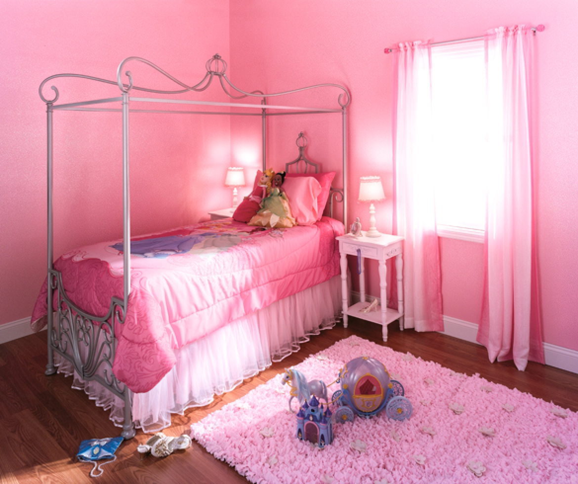 A pink bedroom with pink accents. - 11604