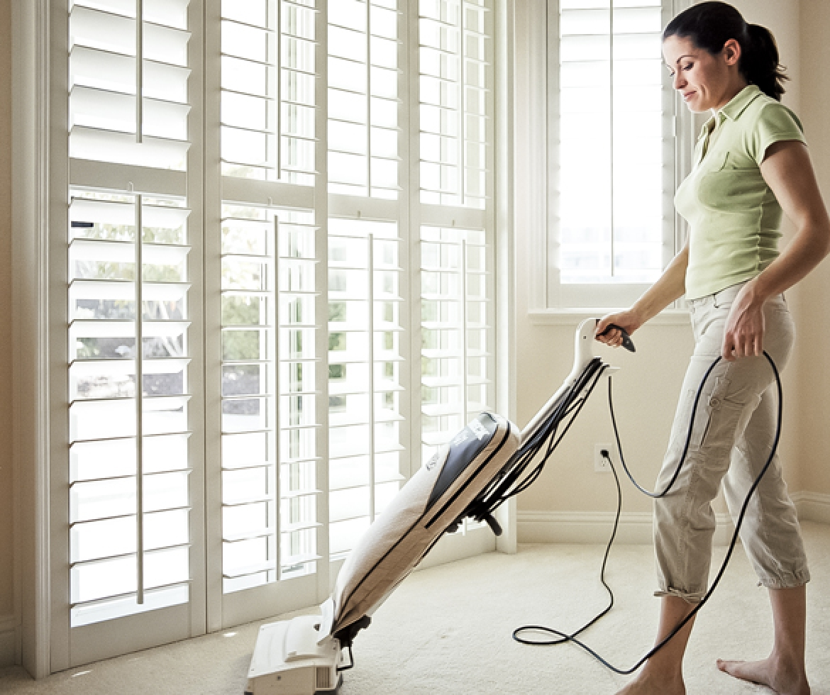 Woman vacuuming floor. - 11457