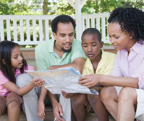 Family looking at a map - 12786