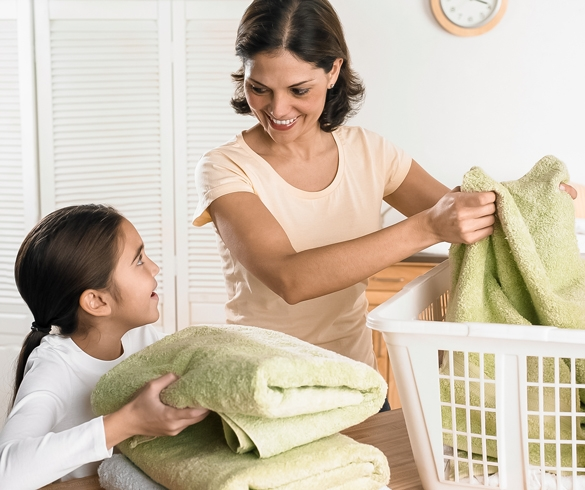Mother and child folding laundry.