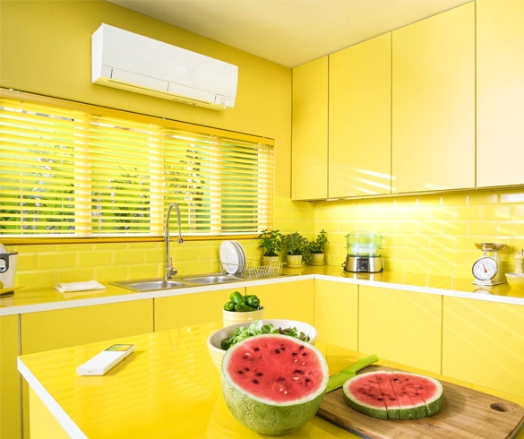 Bright yellow kitchen with indoor climate control unit - 13178