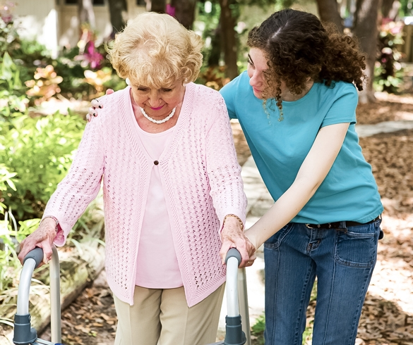 Woman assisting an elderly woman using a walker. re?id=2758
