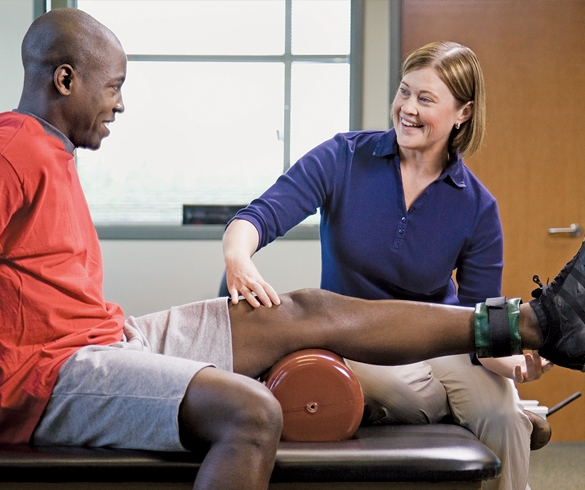 Man doing physical therapy with a therapist - 13234