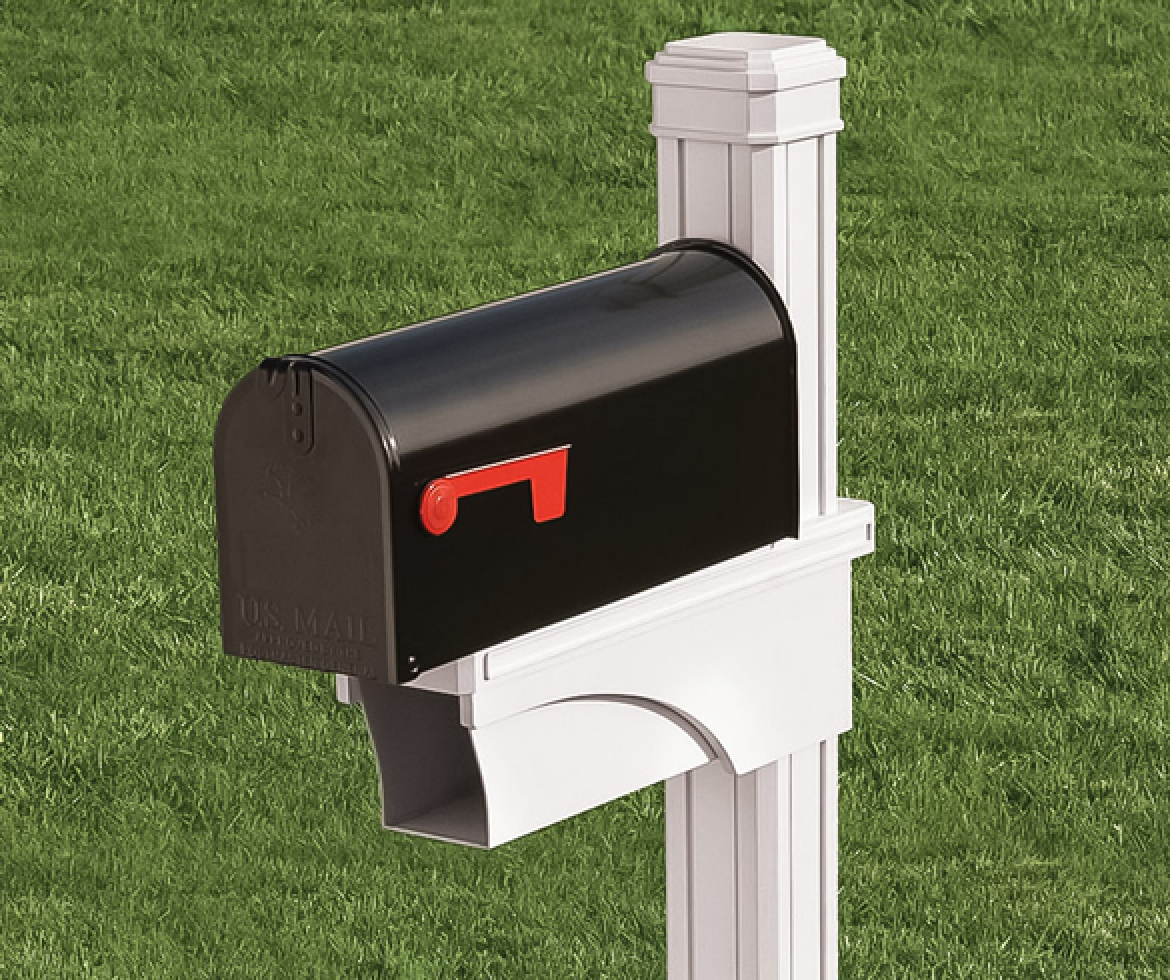 Black mailbox on white post.