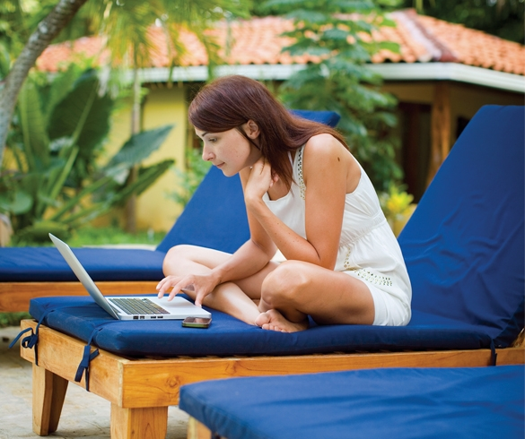 Woman looking at laptop while on vacation - 13262