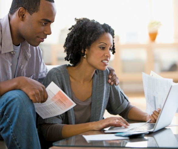 Man and woman looking at financial statements - 13061