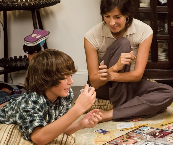 Mother and son playing an indoor board game.