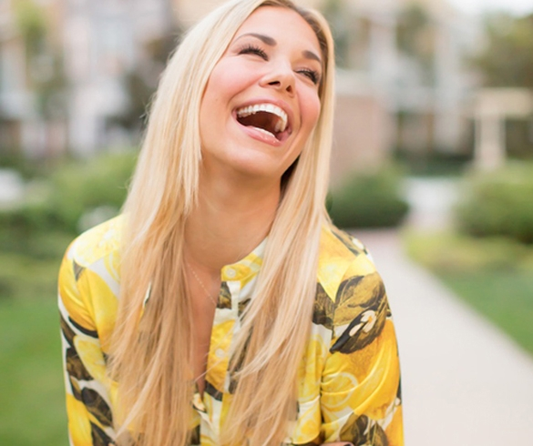 Woman with blonde hair laughing - 13104
