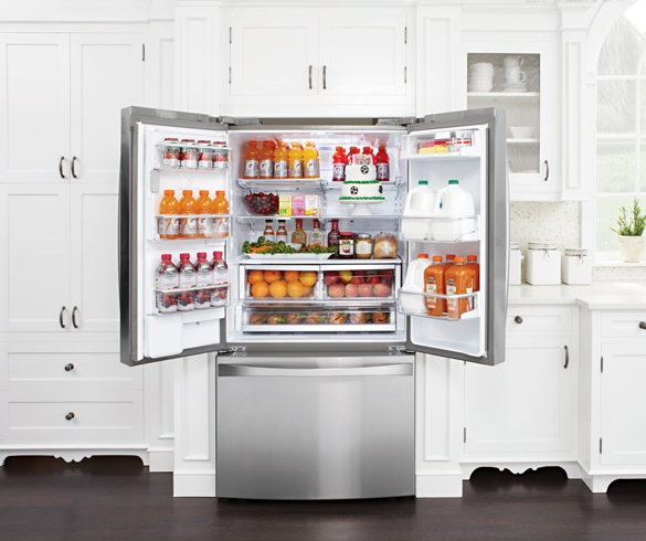 Opened side by side door refrigerator without pullout freezer drawer.