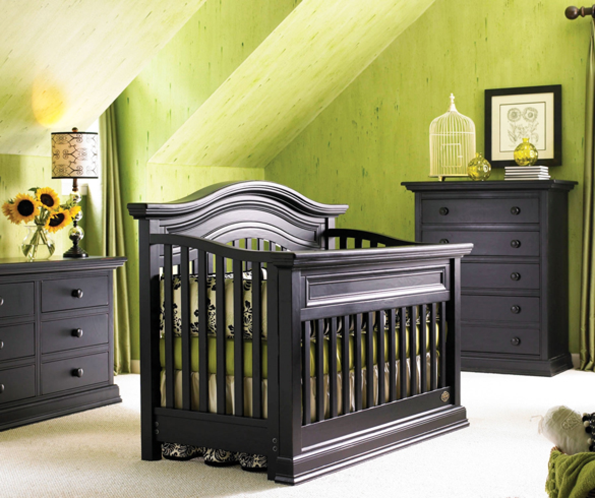 Nursery crib with two dressers.